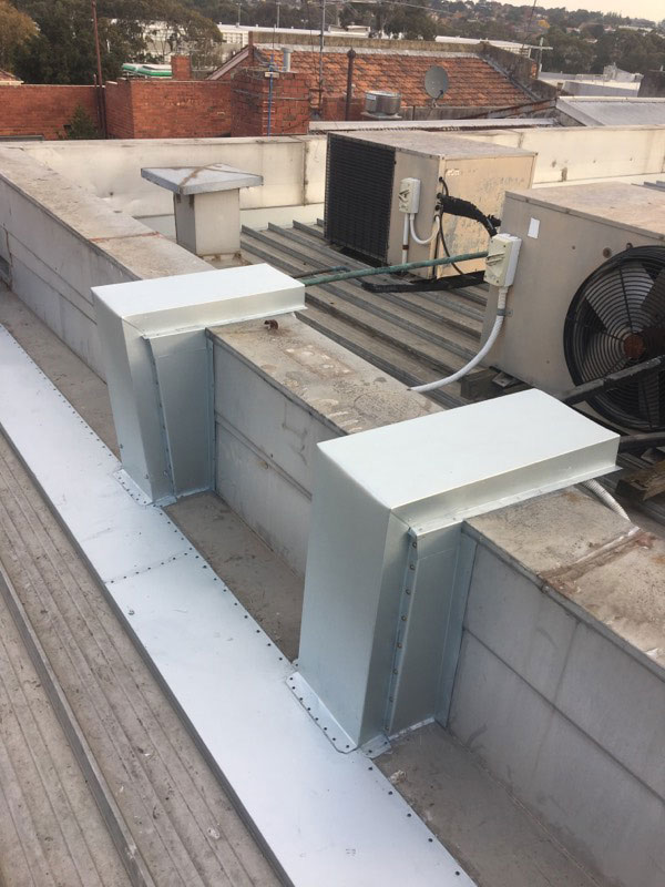 Roof Leaks on Commercial Buildings | Flashing Installed to AC Pipes to Prevent Water Ingress | Melbourne | Roofrite Commercial