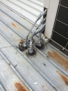 Roof Leaks on Commercial Buildings | Taped AC Pipes to Prevent Water Ingress | Melbourne | Roofrite Commercial